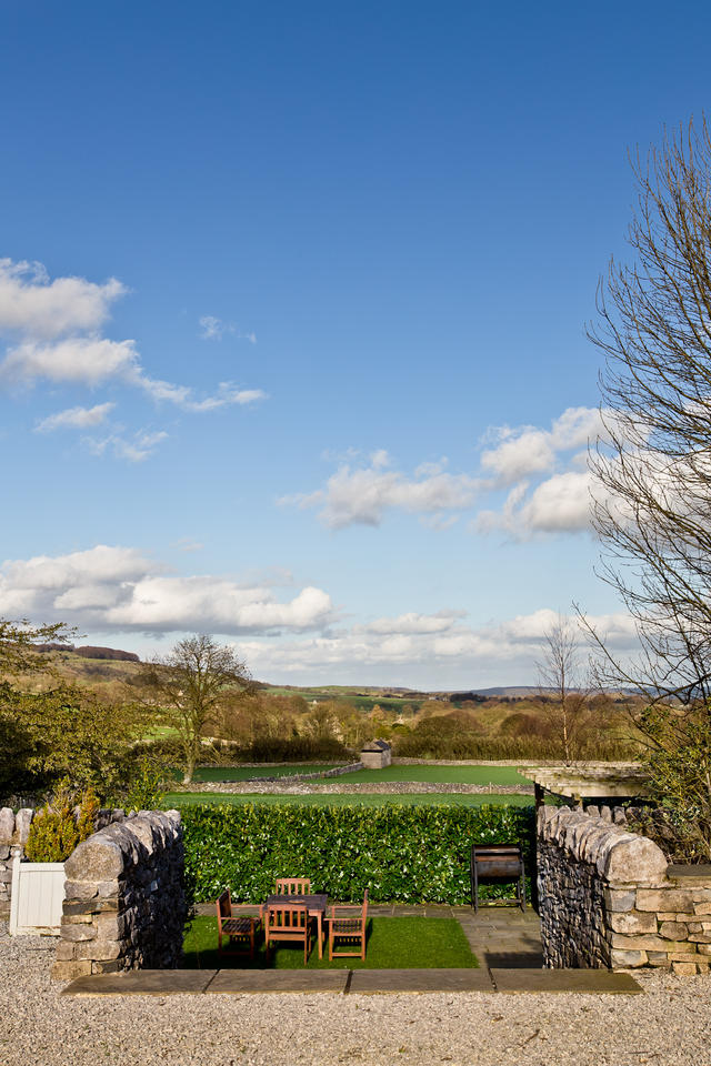 Steps down to the sunken garden with views towards Longstone Edge