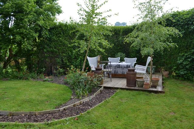 Seating area at bottom of garden