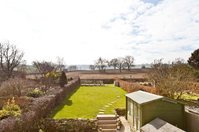 Large enclosed garden with far reaching views to the rear and decked terrace for al freso dining