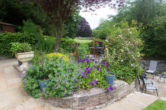 Well established riverside garden