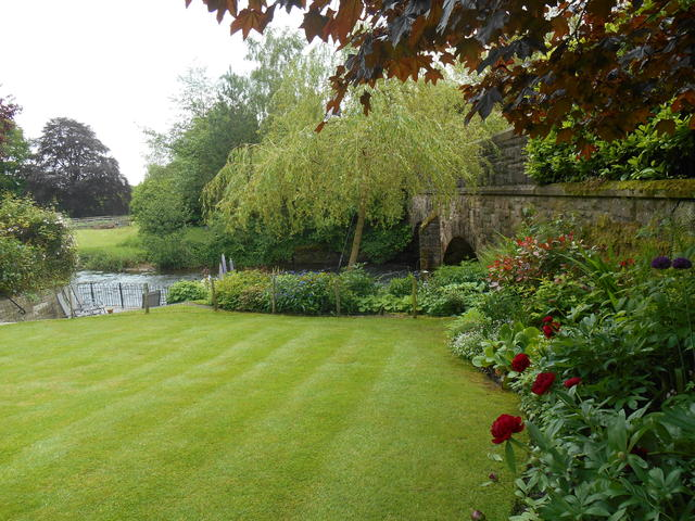 River Cottage has a beautiful garden with a river setting