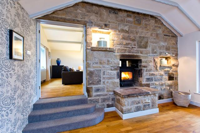 Spacious entrance hall with log burner and view of lounge