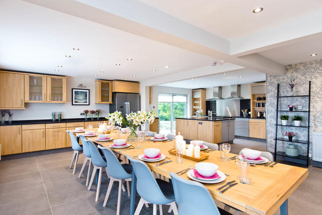 Dining for fourteen guests in the open plan kitchen/dining room