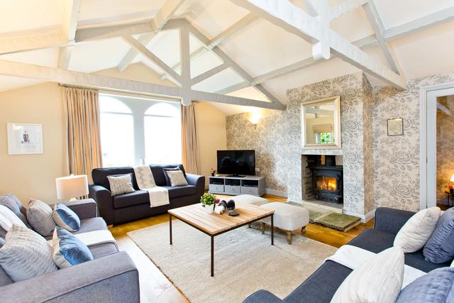 Beautiful lounge with cosy log burner