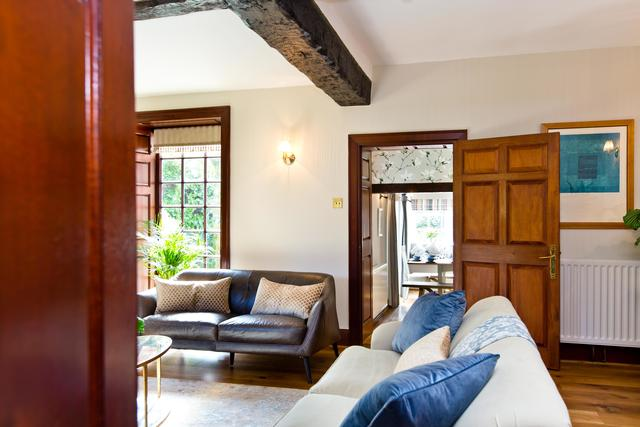 View into sitting room and through to the dining room beyond