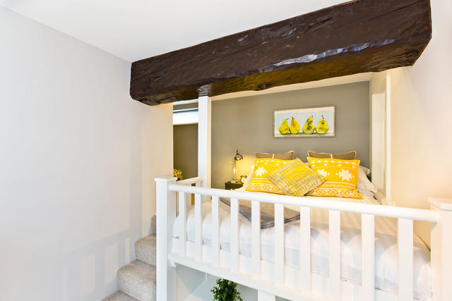 Bedroom 2 with ensuite shower. Please note| raised platform with double mattress (3ft from floor accessed via steps with low ceiling height) – great for children (not suitable for guests with mobility issues as there are steps up to it)