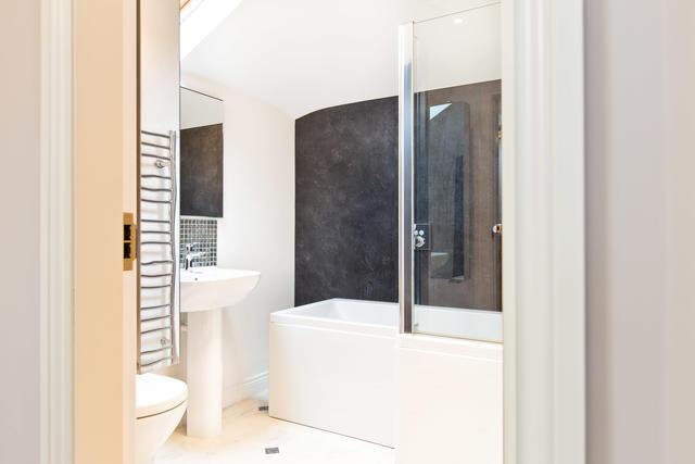 Shared family bathroom with shower over bath