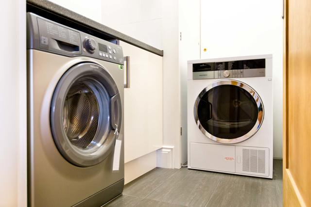 Coin-operated washing machine and tumble dryer