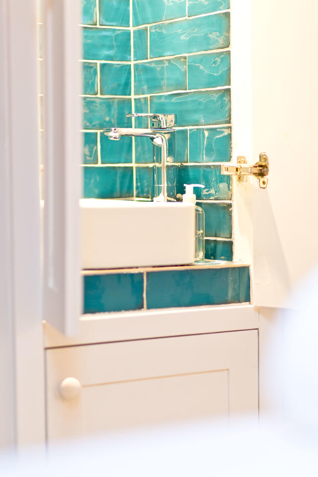 Sink with blue tiles