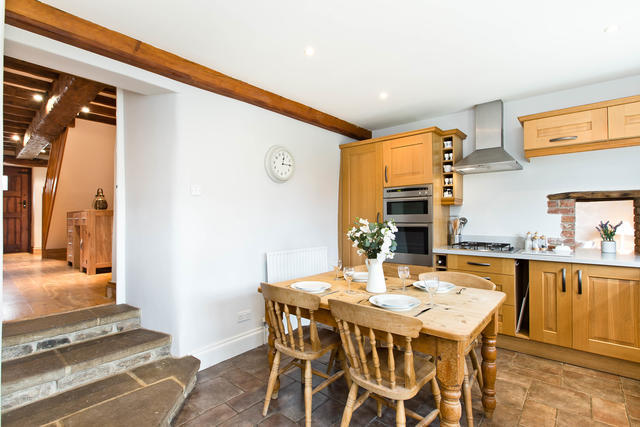 Steps from dining area into kitchen