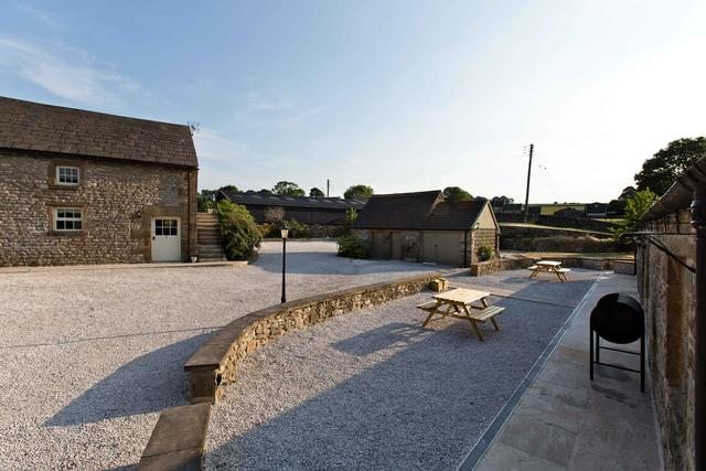 Car parking area and patio area outside the Barn