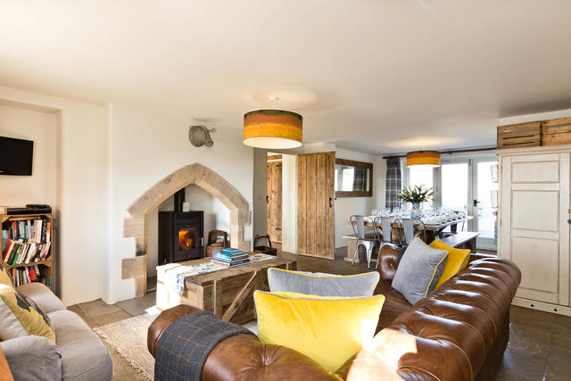 Open plan living/kitchen/dining are with log burner
