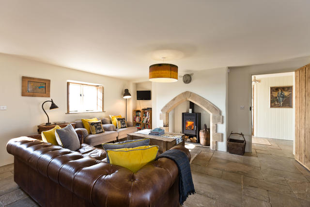 Cosy log burner in open-plan living area