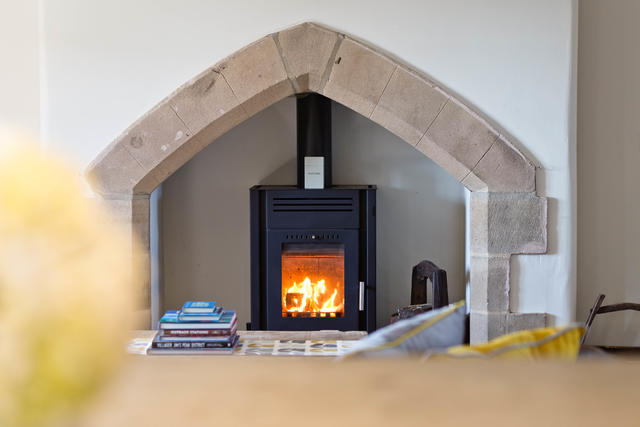 Log burner in open plan area