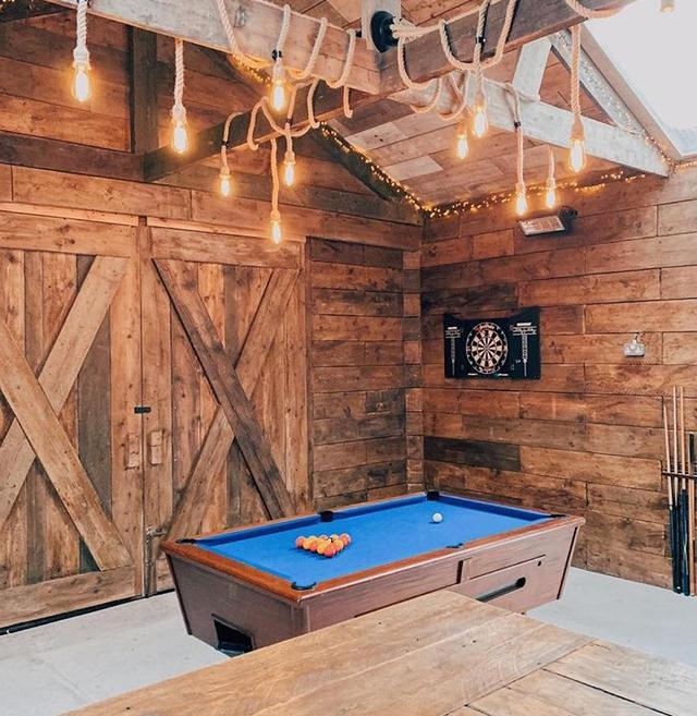 Pool table and darts board in games room