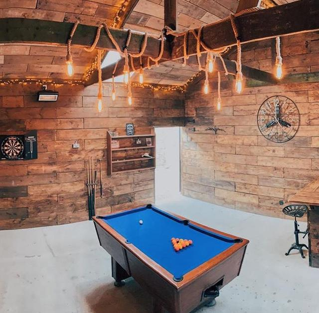 Fabulous games room in rustic barn to the rear of the property
