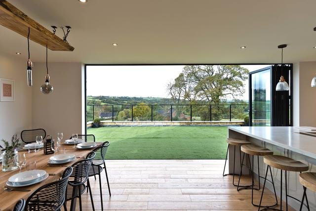 Bifold Doors from the kitchen open to a balcony