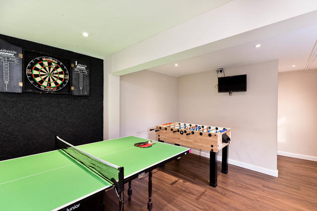 Games Room with junior table tennis table, table football & dart board