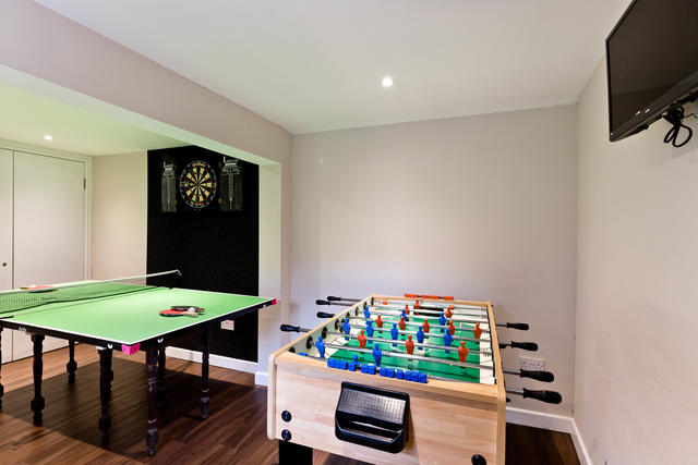 Games room with junior table tennis / table football and darts