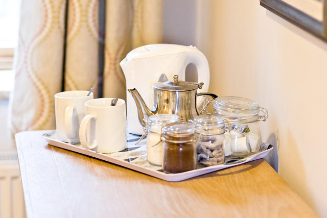 Tea trays in the bedrooms in Etwell Cottage
