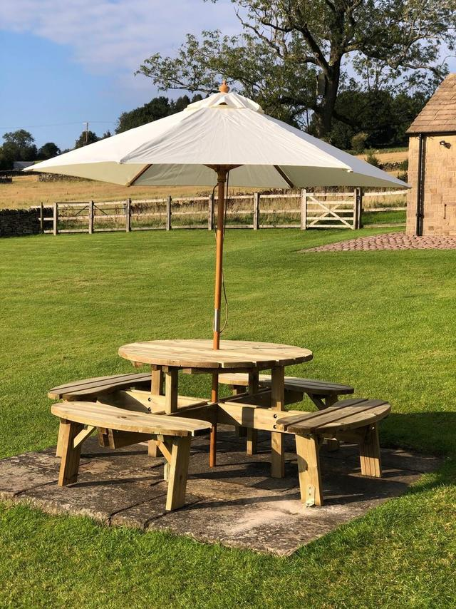 Picnic table and umbrella in the garden