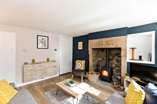 Inviting Sitting Room with log burner
