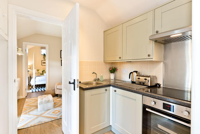 Modern kitchen with electric hob and oven