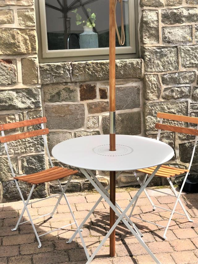 Bistro table outside the annexe