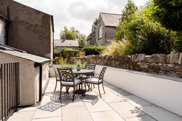 Secluded patio with garden furniture